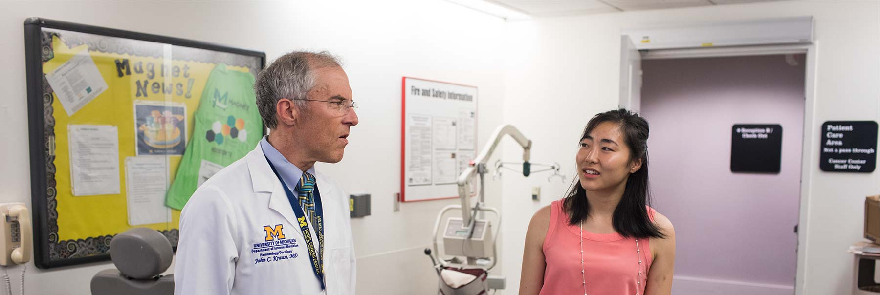 Grace Kanzawa talking with a doctor