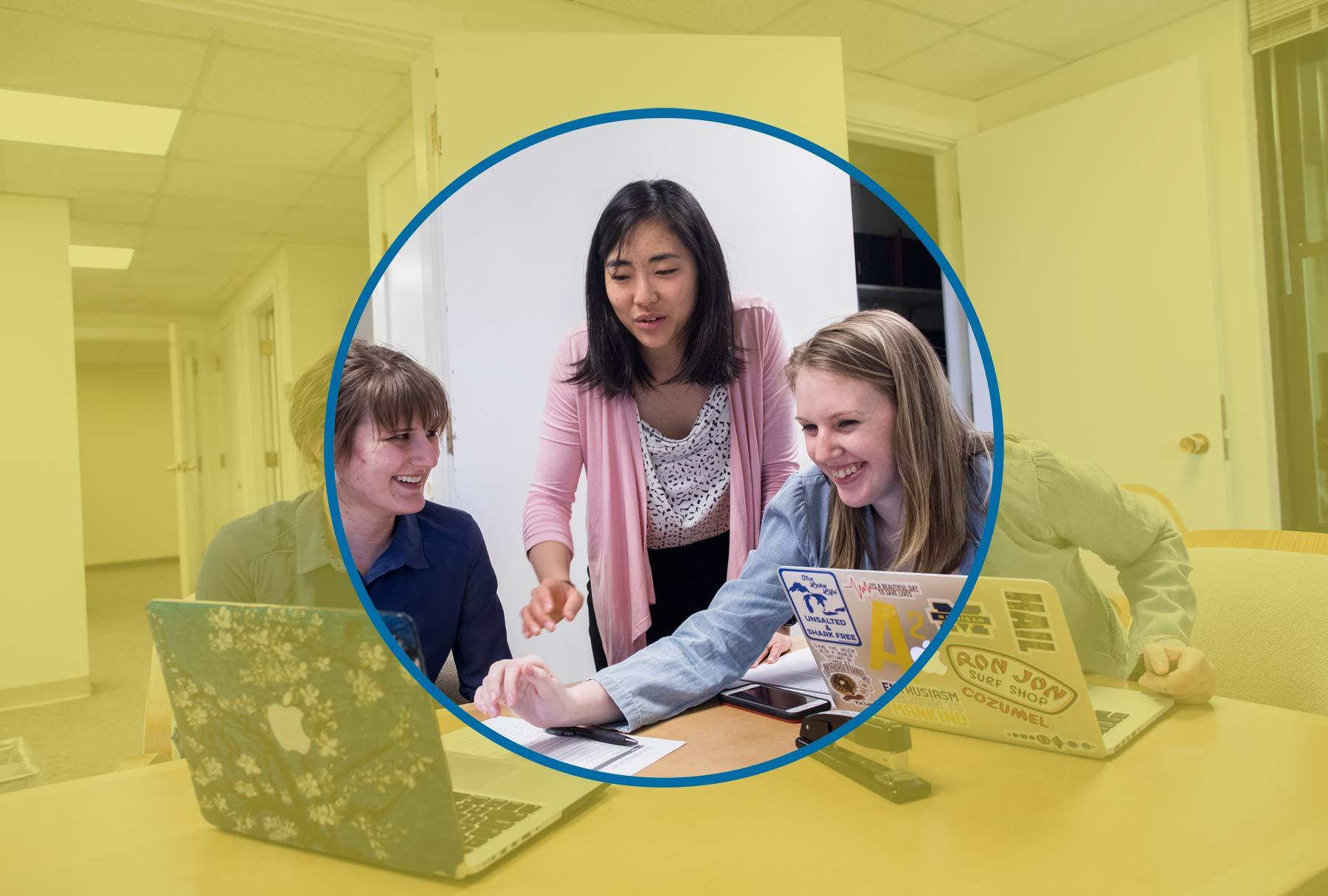 Grace Kanzawa with students using laptops