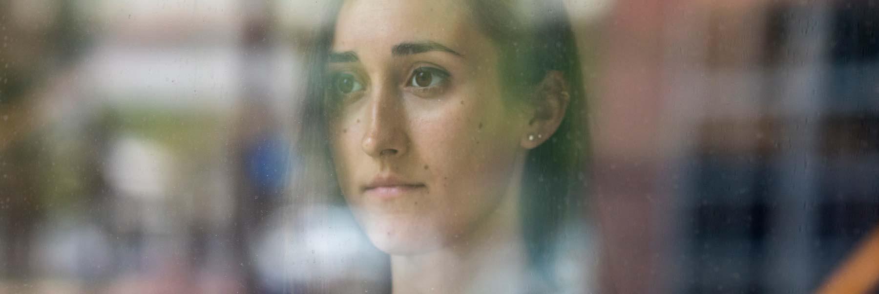 Stefanie Zavodny looking out a window