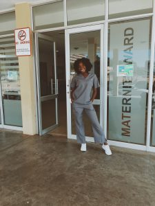 Ebahi Ikharo, standing in front of the maternity ward of Windhoek Central Hospital in Namibia
